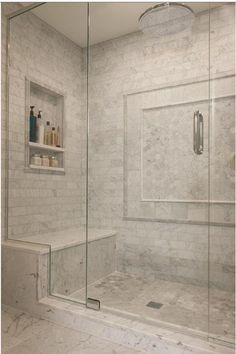 This is how I want shower door to look (including the way it 'wraps' the shower bench). But having so much Carrara looks too busy to me. Master Bathroom Shower, Bathroom Renos, Bathroom Interior, Interior Design Living Room, Small Bathroom, Bathroom Ideas, Basement Bathroom, Washroom, Dream Bathrooms