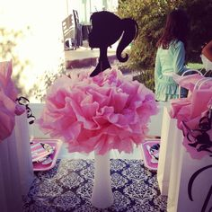 Centerpieces for Barbie party -Dollar store vase painted white, a little floral styrofoam in the center, tissue pom pom and floral card holders. I ordered the Barbie silhouettes on Etsy.