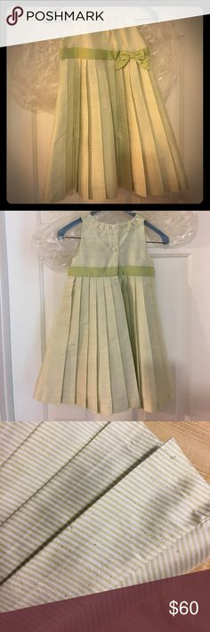 Janie and Jack Special Occ green striped dress 2 Adorable green, pleated and striped silk dress from Janie and Jack.  Recently dry cleaned (a 17.00 investment) but with some minor pulling because...well...it was worn by a 2 year old!!  Please see photos.  Still in great condition! Janie and Jack Dresses
