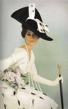 Audrey Hepburn with a long, long pearl necklace from the film 'My Fair Lady'. Vogue shoot 1964