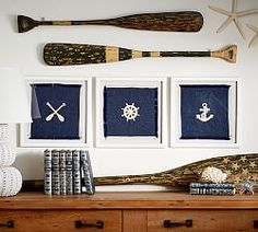 Use my dad's old sailing flags in the white shadow boxes | Pottery Barn