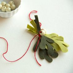 Make this sweet felt mistletoe bunch with a free template download. Easy and fast!