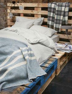 Platform bed from wooden pallets.