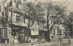 "Main Street, Pune with a Christmas sign in front of ""Poona General Stores""  via: TuckDB Postcards"