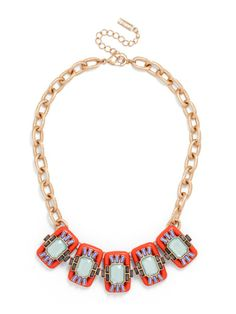 A cool collar is formed of neon resin blocks decked in a neo-tribal flourish of bright gemstones.
