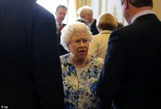Something seemed to be upsetting the Queen today as she spoke to David Cameron (right) and...