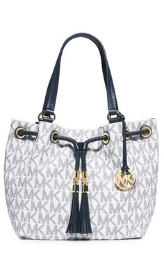 This large travel tote with gold-tone MK charm and hardware is the bag you  need for all of your adventures. 8d9ba1b590