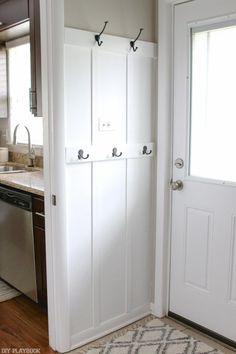 """Love this small """"mudroom"""" area on this stretch of wall. Such an easy DIY project and you are adding major function to a blank wall. A great mini makeover in the laundry room space. ideas entryway laundry Laundry Room Drop Zone with DIY Board and Batten Mudroom Laundry Room, Laundry Room Organization, Laundry Room Design, Ikea Laundry, Mud Room Garage, Laundry Drying, Laundry Storage, Design Kitchen, Car Garage"""