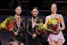 2011 World Championships Podium. Miki Ando (1st), Yuna Kim (2nd), Carolina Kostner (3rd)