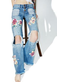 One Teaspoon Orchid Distressed Bell Bottoms fer when yer feelin' the flower power, babe. These bell bottom jeans feature a slim but loose fit, distressed details all over, a button front closure, a raw hem, and orchids printed all over.