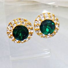 These Swarovski green emerald and white diamond earrings are just spectacular! They feature a large round emerald green Swarovski crystal surrounded by dozens of . Swarovski Jewelry, Rhinestone Earrings, Crystal Jewelry, Swarovski Crystals, Diamond Earrings, Gold Jewellery, Beach Jewelry, Etsy Jewelry, Emerald Green