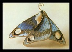 Gold butterfly brooch with enamel and moonstones by Eugene Feuillâtre, ca. 1900