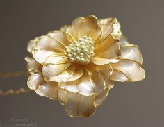 Handmade Hair Pin Peony. Creamy with gold center.  The Flower petals slightly transparent. They are very thin, probably 0.2 mm, however they are strong enough not to be broken if will fall on the floor.  The flower is around 2.8 inch in diameter. The weight is 13.6 gr.  The picture cant reproduce the flower magic.  The flower is attached to Gold plated Hair Pin 10 cm.  This piece is graceful and exotic.  Ready to ship.  Thank you for interest to my art work. Alexandra.