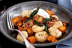 gnocchi is tossed with roasted pumpkin, goats cheese and walnuts