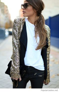 White top, black pants and gold jacket