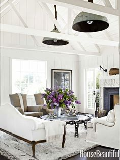 A Chic California Beach House. Thirty Inch Buoy Lights, From Erin Martin  Design, Hang From Ropes. A Pair Of Antique French Chairs Are Upholstered In  Natural ...