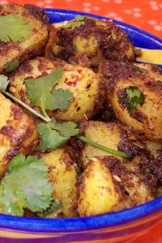 Aloo Potatoes with Cumin Indian Recipe  1	pound	cooked potatoes* 3–4	tablespoons	vegetable oil 1/2	inch	freshly grated ginger 1/2	teaspoon	cumin seeds 1	teaspoon	ground cumin 3/4	teaspoon	red chili powder 1/3	teaspoon	turmeric 1/2	teaspoon	amchur (mango) powder 1	teaspoon	salt 1/2	teaspoon	freshly ground black pepper 1/2	cup	cilantro, chopped . *Use firm, thin-skinned potatoes such as Yukon Gold.