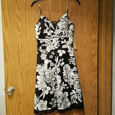 NWT OC by Oleg Cassini floral a-line dress sz 6 Dress is NWT. Lined throughout including lined shaped cups (you probably won't need to wear a bra). Lace detail at bust and bottom of dress. Adjustable spaghetti straps. Super flattering. Oleg Cassini Dresses