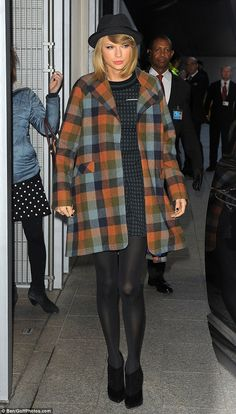 Check her out: Taylor Swift headed to the Shard in London in the early hours of the morning wearing an on-trend checked coat
