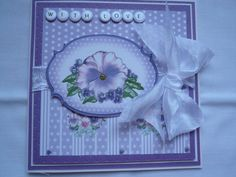 Papers and topper from card making magazine matted and layered. Two inch wide ribbon wrap and bow. Greeting hand written on card candy