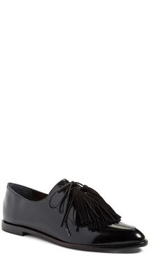 b6345427509 Striking tassels update a modern lace-up loafer crafted from luxe genuine  calf hair or