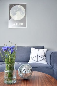 Sweet flowers contrasted against a glam disco ball. Peace cushion and moon framed art Living Room Art, Home And Living, Dcor Design, Design Ideas, Modern Wall Decor, Home Interior Design, Home Projects, Home Remodeling, Table