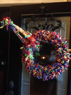Birthday Wreath.  Says it takes $11. to make.  Its made out of cut up felt strips