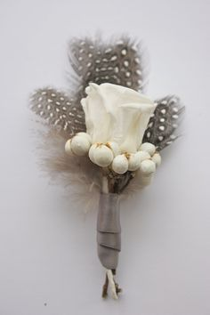 Beautiful, unique, simple, and lasts forever! Feathered Rose Boutonniere. $12.00, via Etsy.
