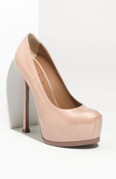 Textured patent leather is shaped into a vertiginous pump with a skinny wrapped heel and concealed platform.