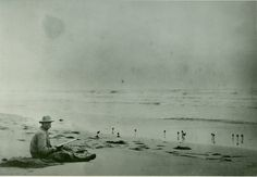 George Doughty, lighthouse keeper at Broadwater on Hog Island, hunting robin snipe on the beach cicra 1900. Photo by Rudolph Eckemeyer. via Barry Truitt - Southern Decoy Collectors Facebook.
