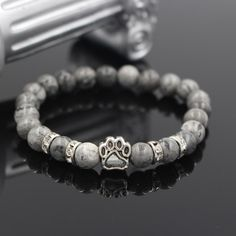 Is your empty wrist looking dull? Get this dog paw print bracelet and make everyone envy you. This beautiful and unique design is popular among girls and women. Yoga Bracelet, Stone Bracelet, Rebel Fashion, Elastic Rope, Cat Shoes, Dog Shop, Marble Stones, Stone Beads, Fashion Bracelets