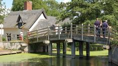 In the heart of the beautiful Dedham Vale lies the charming hamlet of Flatford, East Bergholt, UK, the location for some of John Constable's most famous paintings. Walk over the small wooden bridge at the Flatford Bridge Cottage for fantastic views over the River Stour.