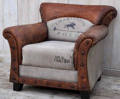 Charleston Polo Vintage Arm Chair - $1300RRP AUD   This beautiful Recycled Canvas and #leather Designer #armchair is part of collection a inspired by the #Industrial era . The #vintage style evokes a raw industrial feeling and look that oozes #English charm and sophistication. The printed canvas creates a unique element to this wonderful designer chair. The #Hardwood legs, Leather and Up-cycled #Canvas, means this chair is as good for the environment as it is for your living room.
