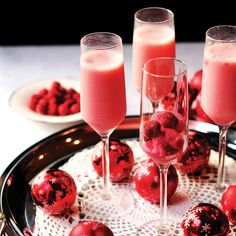 Save this cocktail recipe to sip on Raspberry Cream Mimosa during the holidays.