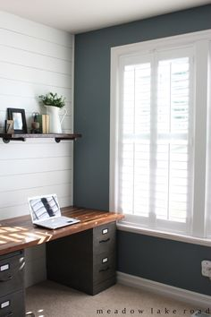 Wood shutters on the windows in our home office to provide privacy while still allowing light in - www.meadowlakeroad.com @blindsdotcom #shutters