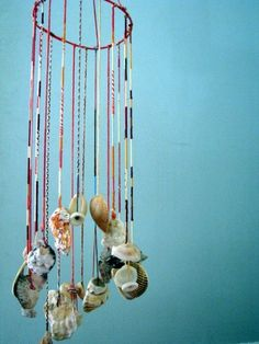 mobile craft with colorful string and seashells - think ombre style with a color scheme instead of rainbow colors!