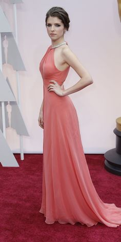 """#oscarfashion FEBRUARY 22, 2015 Anna Kendrick. Ms. Kendrick was one of the first A-listers to walk the carpet once the preshow cameras were rolling. Ms. Kendrick's coral silk georgette gown, a custom piece by the New York designer Thakoon Panichgul, dominated the early red-carpet conversation on Twitter. (She was in a frothy Monique Lhuillier at the Golden Globes.) Maybe playing Cinderella in """"Into the Woods"""" rubbed off?  Noel West for The New York Times"""