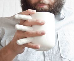 Insert a little human interaction into your lonely morning routine with the holding hands coffee mug. This creative coffee mug forgoes the traditional handle and opts for a contemporary and intriguing design specifically molded to the human hand. Face Mug, Creative Coffee, Glass Of Milk, Holding Hands, Coffee Mugs, Cups, Mugs, Coffee Cups, Coffeecup