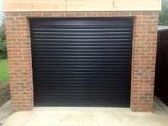 RSG7000 Electrically Operated Security Roller Garage Doors fitted externally to a residential complex in Tooting