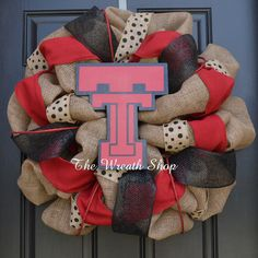 Cheer on your favorite alma mater this fall with this Texas Tech Burlap Wreath, in red and black. Logos are hand cut and painted to match your school.