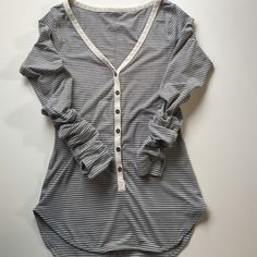 Lululemon long sleeve shirt, size 4, gray striped It kills me to get rid of this but I'm just too short (5'2'') it's just a touch too long on me. It's made of rulu which is the softest and cozier fabric! The cut is SO flattering. No trades. lululemon athletica Tops Tees - Long Sleeve