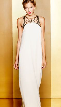white maxi with gold leather straps