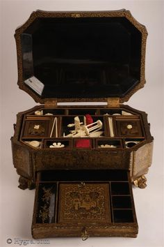 Antique Chinese Export Lacquer fully fitted sewing box with gold decoration depicting scenes of Chinese life Circa 1835