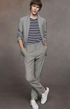 A tailored modern-fit blazer and trousers in an Italian-woven cotton wool blend with a micro houndstooth pattern. Blurring the lines between smart and casual, the tailored trousers are detailed with a drawstring at the waist.