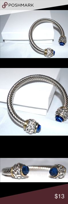 Faux Sapphire Twisted Metal Half Moon Bracelet Faux Sapphire Twisted Metal Half Moon Bracelet Half metal twisted metal bracelet with gold tone accent details. Faux sapphire stone jewel settings. Simple bracelet can be worn as a layering look or by it's self. #simple #bracelets #fashion #jewelryaccessories hausofurbanite Jewelry Bracelets