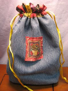 Recycled Jeans - A Drawstring Bag!  http://www.hookedonneedles.com/2009/08/recycled-jeans-drawstring-bag-this-time.html#