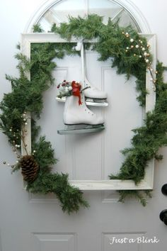 Picture Frame Wreath. I love this one - but would be great on the wall as well with a family Christmas pic inside each year (maybe in another smaller frame inside). Pretty Christmas decorations! I love the old skates!!!