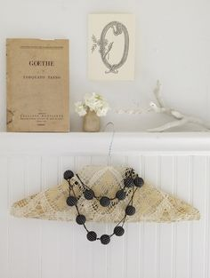 More doily creations from a 2009 Country Living story. Hanger covered in antiqued doily. #sweetpaul
