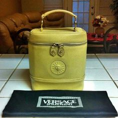 Rare Versace bucket purse Rare authentic true vintage bucket purse. Signs of wear as seen from the picture. In good condition for its age and for being a vintage. Perfect for versace lover and vintage collector/lover.  Perfect for girls who love unique and one of a kind piece. You'll never see something like this anymore. Use offer feature for offer. Versace Bags Totes