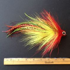 bright yellow and red musky fly